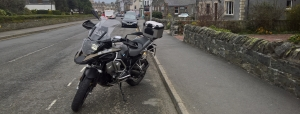 Motorcycle parked at side of road in Peebles
