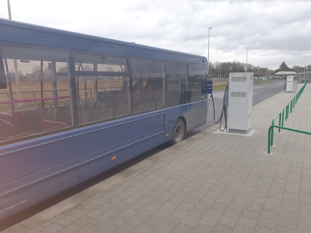 Image of number 59 route electric bus at Poppleton Bar Park and Ride outside York.